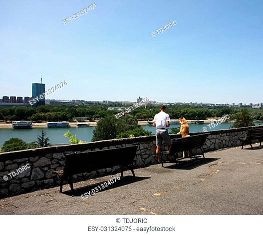 Akita Inu with its owner enjoying beautiful city view