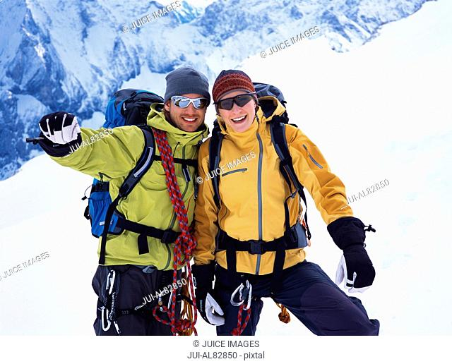 Couple of hikers smiling on snowy mountain
