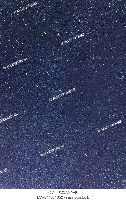 Blue dark night sky with many stars. Milkyway cosmos backgroundConstellations Auriga, Taurus, Perseus, Gemini, Orion