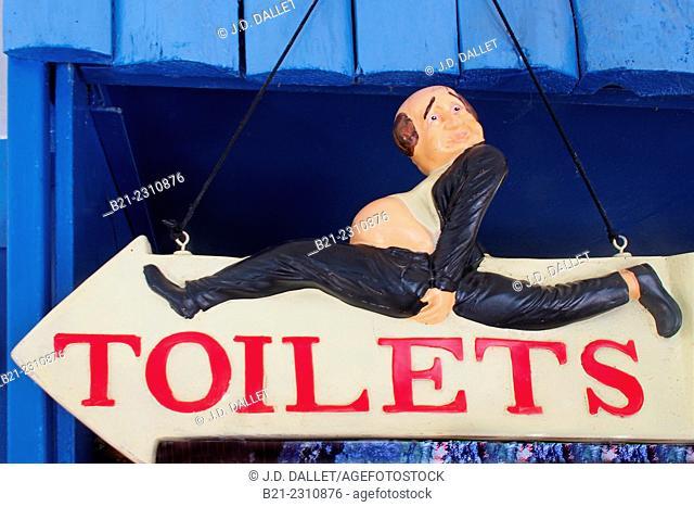 "France. Aquitaine. Gironde. ""Toilets"" sign at Restaurant Quinquin, at Macau, on the Gironde estuary"