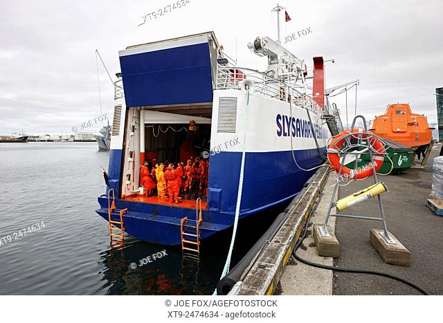 students with immersion suits undergoing maritime search and rescue training on ship reykjavik iceland