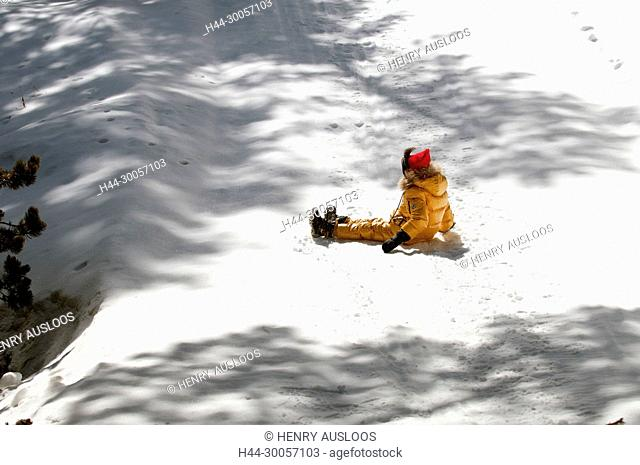 Child slides on the snow