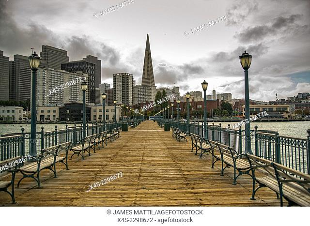 The San Francisoc skyline from an old pier in the bay, as a storm approaches