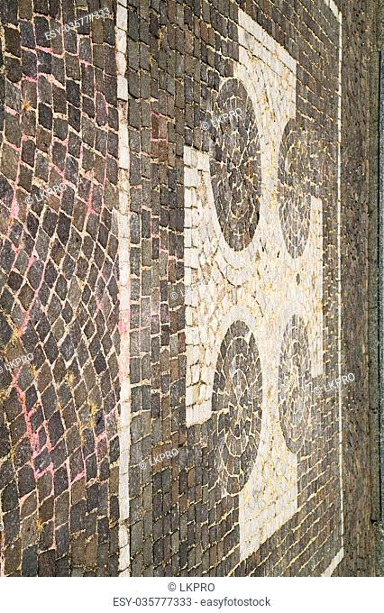 vanzaghello street lombardy italy varese abstract pavement of a curch and marble