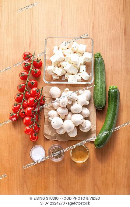 Ingredients for feta and vegetable skewers