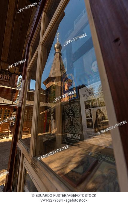 Temple of the Kazan Icon of the Mother of God reflected in a glass of the book shop in Vyritsa, Leningradskaya oblast