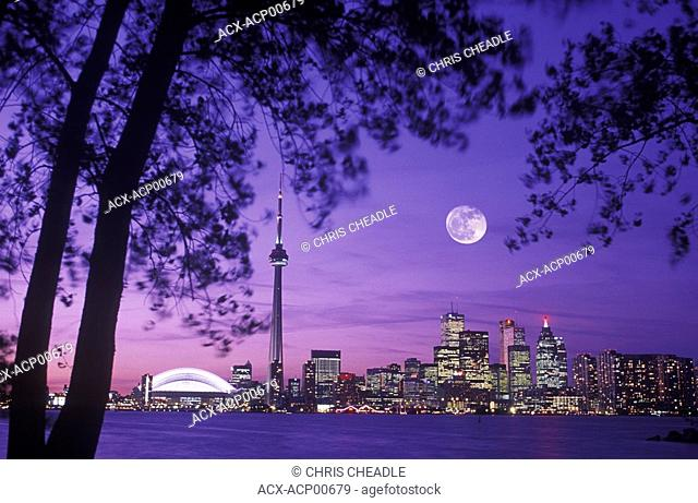 Skyline with CN tower at dusk with moon, Toronto, Ontario, Canada