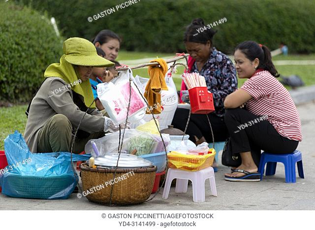 Woman selling food on the street around the royal palace, Pnom Penh, Kingdon of Cambodia