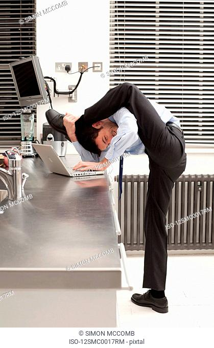 businessman stretching in the kitchen