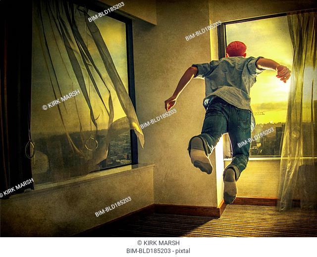 Caucasian man flying through window
