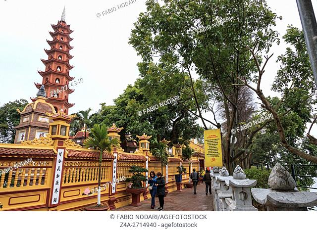 Tourists visiting the Tran Quoc Pagoda in Hanoi, Vietnam
