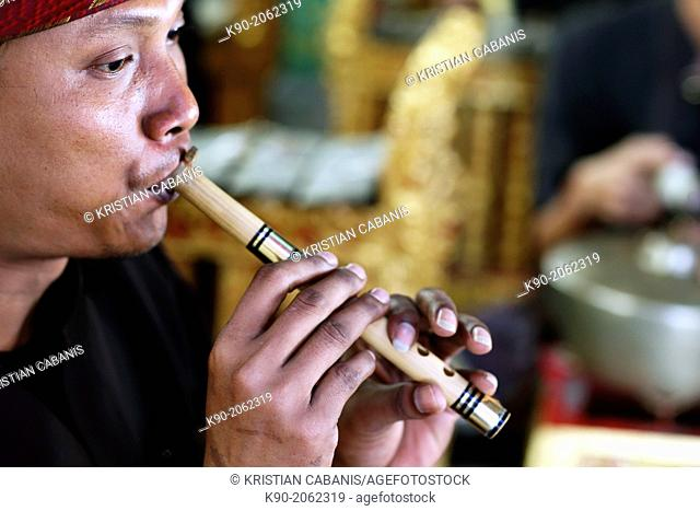 Gamelan - traditional balinese orchestra and musicians, Man playing fluete, Bali, Indonesia, Southeast Asia