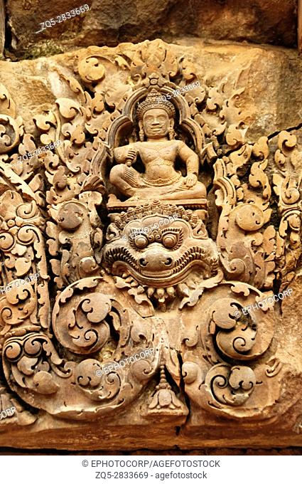 Carvings of gods over a door. Banteay Srei temple, Angkor, Cambodia. The citadel of women, this temple contains the finest
