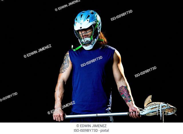 Portrait of lacrosse player, black background