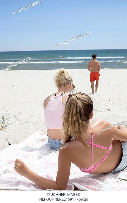 Teenage girls sunbathing on beach