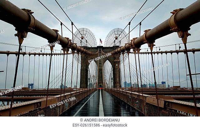 Brooklyn Bridge closeup over Hudson River in New York City