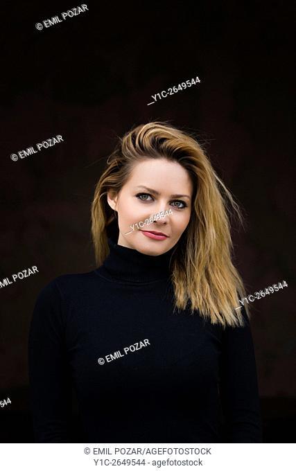 Portrait young woman against Black background