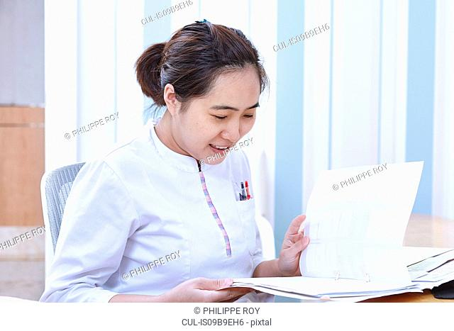 Doctor reading medical records