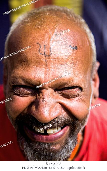 Portrait of a sadhu smiling in Kumbha Mela, Allahabad, Uttar Pradesh, India