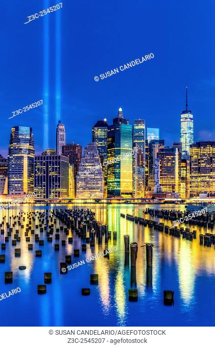Manhattan NYC 911 Tribute - Two beams of light shine high into the blue sky at the lower Manhattan skyline during the 911 Tribute In lights memorial