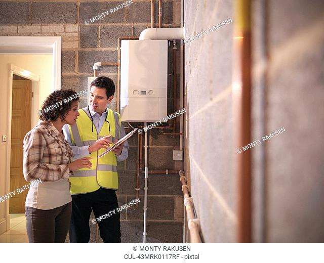 Energy worker talking with woman