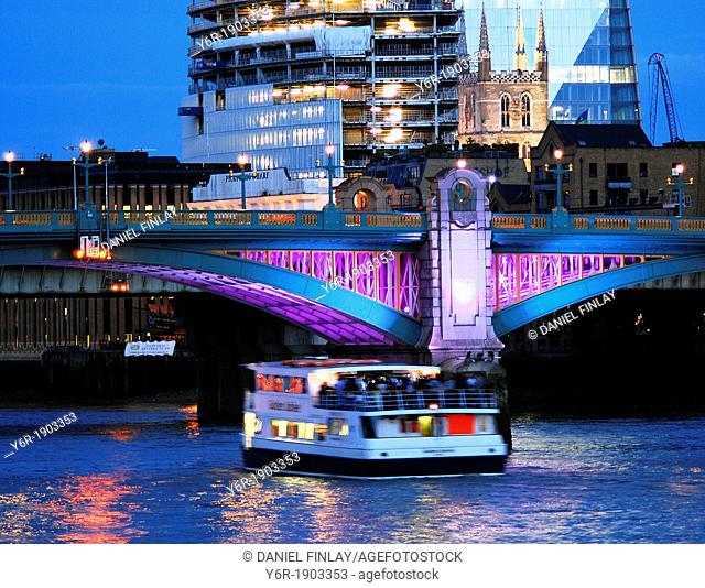 The mediaeval tower of Southwark Cathedral on the banks of the River Thames in the heart of London, England, with Europe's highest building, The Shard