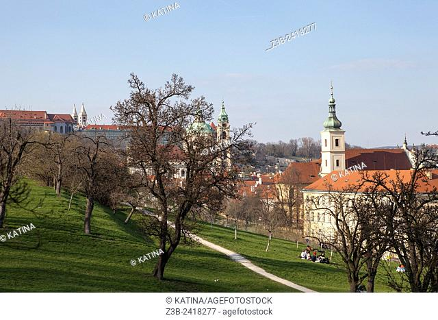 Prague's Petrin Hill blooming in spring with the Church of Our Lady Victorious at the base of Petrin Hill, Prague, Czech Republic, Europe