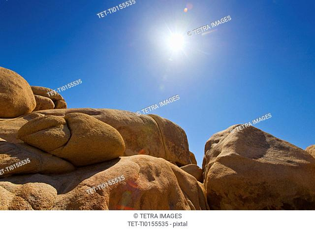 USA, California, Joshua Tree National Park, Desert rocks with solar flare