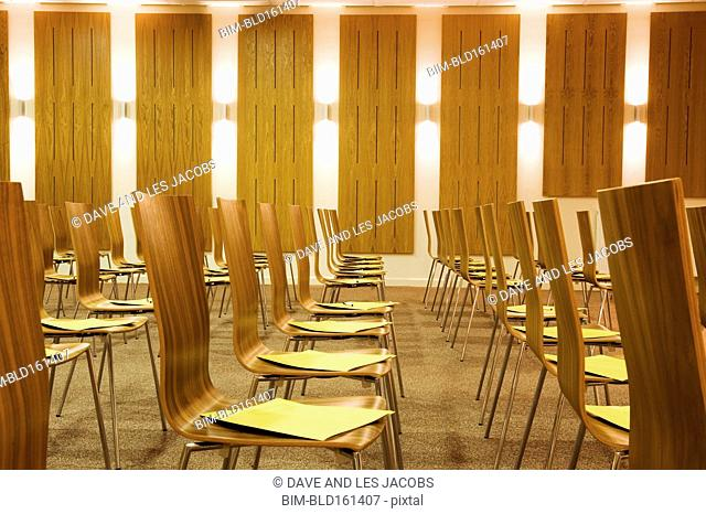 Empty chairs in presentation room