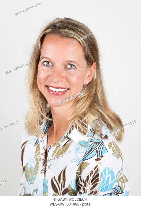 Mature woman smiling, portrait, close up