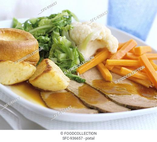 Roast beef with Yorkshire pudding and vegetables UK