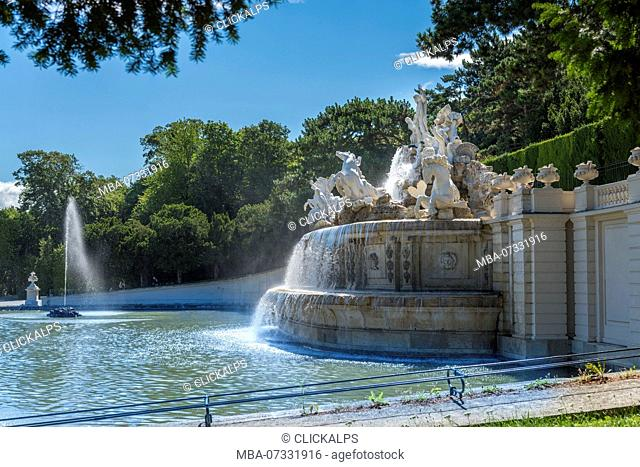 Vienna, Austria, Europe. The Neptune Fountain in the gardens of Schönbrunn Palace
