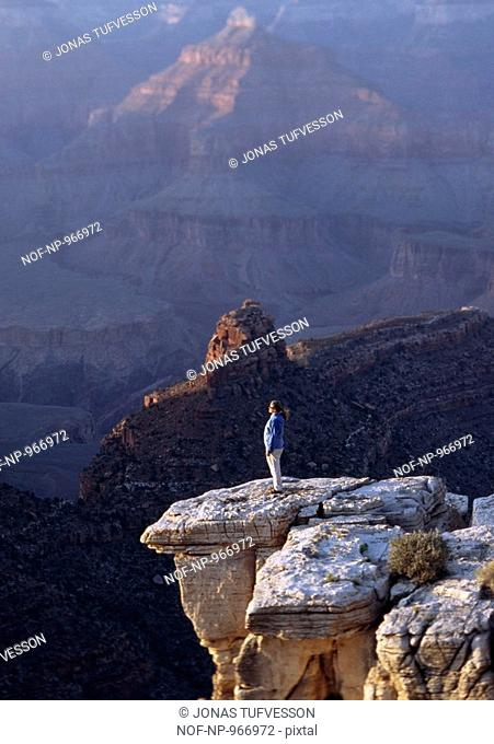 A woman by the Grand Canyon, Arizona, USA