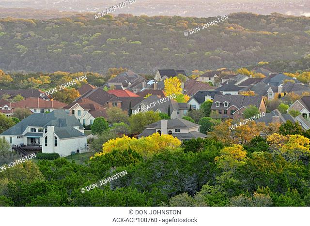 Overlooing Hill Country bedroom communities at sunrise, Austin, Texas, USA