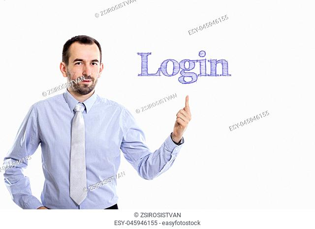 Login Young businessman with small beard pointing up in blue shirt - horizontal image