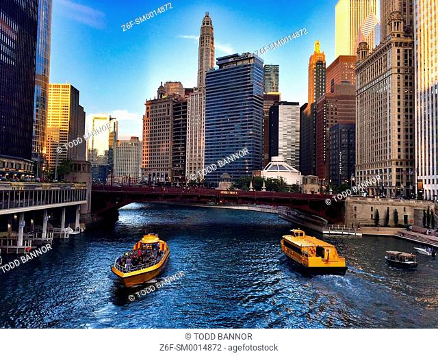 Chicago River, downtown Chicago. Excursion boat and water taxi