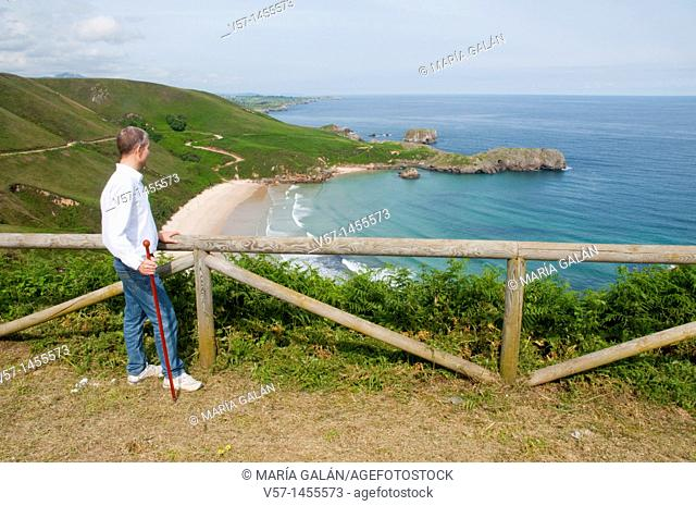 Man at the viewpoint over Torimbia beach. Niembro, Asturias province, Spain
