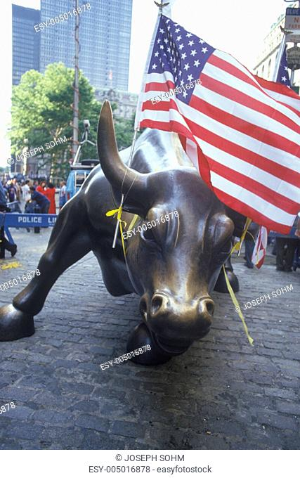 American Flag Tied to Sculpture of Bull, Wall Street, New York City, New York