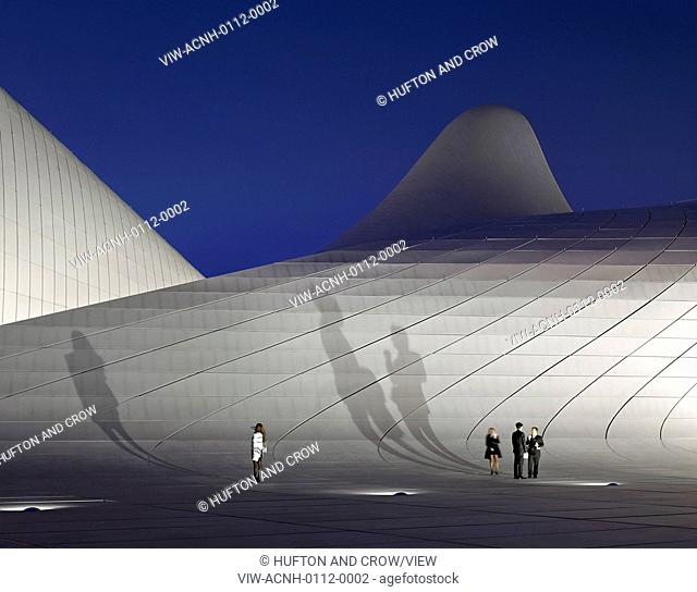 Heydar Aliyev Cultural Center, Baku, Azerbaijan. Architect: Zaha Hadid Architects, 2013. Undulating exterior facade with projected figure shadows