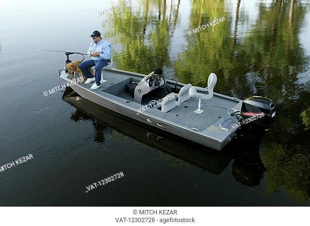 Fisherman In John Boat On Lake