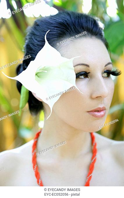 Woman wearing a large flower in her hair