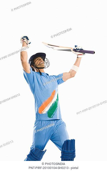 Cricket batsman waving his arms in celebration