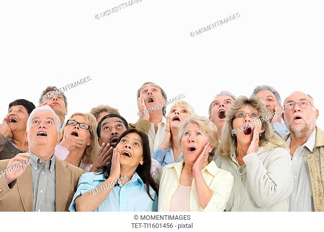 A group of shocked people looking up