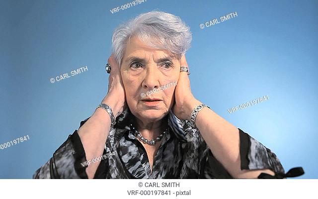 CU Lockdown, A senior woman covering her ears and looking displeased
