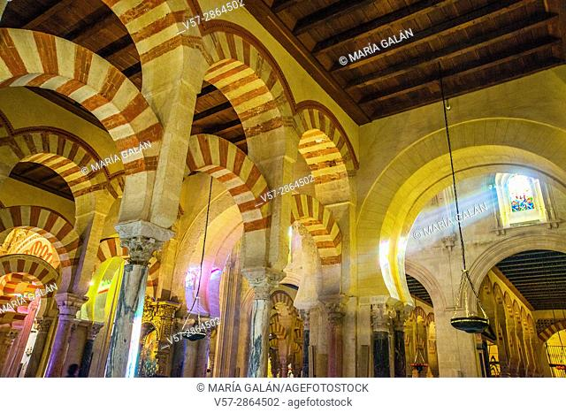 Arches and ray of light through a glass window. Mosque-Cathedral, Cordoba, Spain