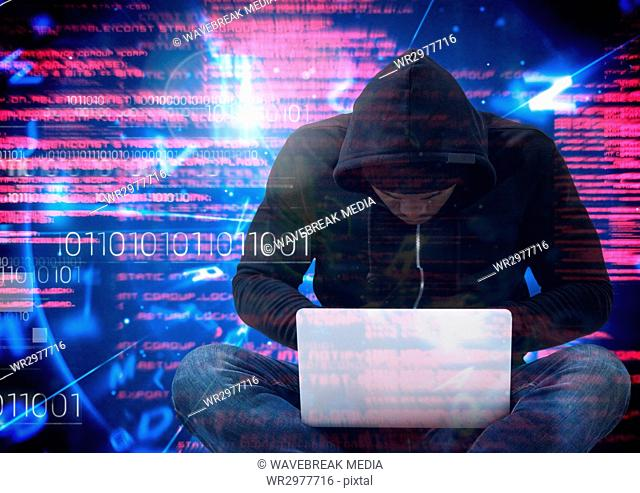 Hacker with legs crossed using a laptop in front of digital background
