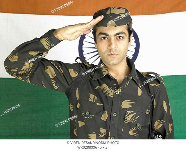 Indian army soldier saluting in front of flag of India in background MR702A