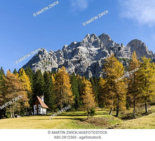 Tamer mountain range in the Dolomites of the Veneto, road leading up to Passo Duran. The Dolomites of the Veneto are part of the UNESCO world heritage