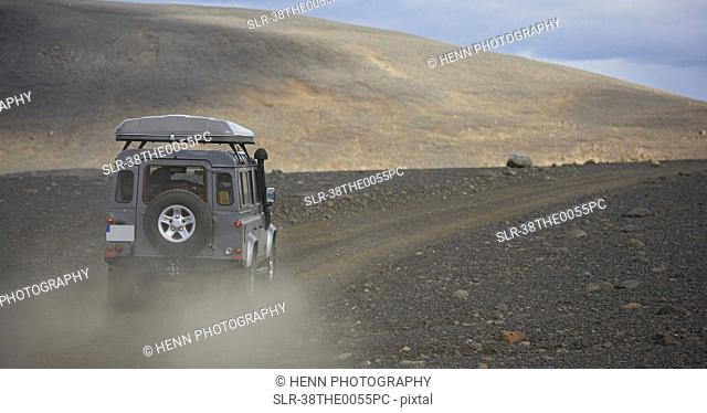 Jeep driving on dirt road