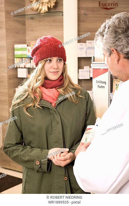 Young Woman In Pharmacy, Munich, Bavaria, Germany